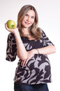 Beautiful pregnant woman with green apple Royalty Free Stock Photo