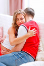 Beautiful pregnant woman hugging her husband Stock Image