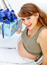 Beautiful pregnant woman with present for her baby Stock Photography