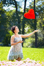 Beautiful pregnant woman with a red heart Stock Images
