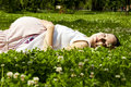 Beautiful pregnant woman relaxing on grass Royalty Free Stock Photo