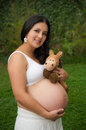 Beautiful pregnant woman relaxing outside in the park this image has attached release Stock Photography