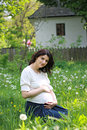 Beautiful pregnant woman relaxing in the park Royalty Free Stock Photo