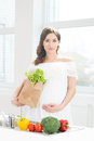 Beautiful pregnant woman with a shopping bag Royalty Free Stock Photo