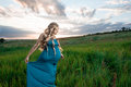 Beautiful pregnant woman standing on green grass Royalty Free Stock Photo