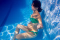 Beautiful pregnant woman underwater blue pool Stock Images