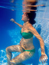 Beautiful pregnant woman underwater blue pool Stock Photo