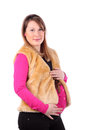 Beautiful pregnant woman wearing in fur vest Stock Photo