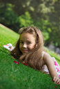 Beautiful preteen girl enjoying her time outside in park with su Royalty Free Stock Photo