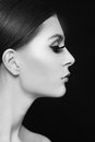 Beautiful profile black and white portrait of young woman with extended eyelashes Royalty Free Stock Images