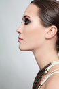 Beautiful profile portrait of young woman with smoky eyes Royalty Free Stock Photography