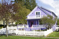 Beautiful purple house this with white trims and fence stood out in the old neighborhood Royalty Free Stock Images