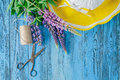 Beautiful purple lupine with leaves, scissors and hemp threads. Royalty Free Stock Photo