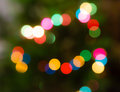 Beautiful rainbow background with blurred bokeh. Merry christmas