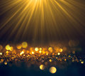 Beautiful rays of light with glitter lights grunge background, g Royalty Free Stock Photo