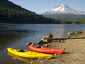 Beautiful recreation area couple colorful kayaks shore trillium lake mount hood oregon Royalty Free Stock Images