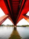 Beautiful red bridge across river Royalty Free Stock Photos