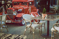 Beautiful red car in the city retro cafe Royalty Free Stock Photo