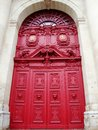Beautiful red doors lion heads arched window paris france Stock Photos