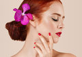 Beautiful red hair woman portrait with flower in hair perfect make up manicure