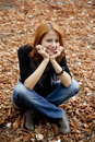 Beautiful red-haired girl in autumn park Royalty Free Stock Image