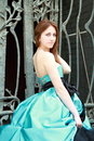 Beautiful red haired girl in blue dress Royalty Free Stock Images