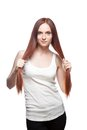 Beautiful red haired girl holding her hair Stock Photo