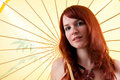 Beautiful red haired girl with parasol Stock Photos