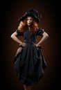 Beautiful red-haired girl in the witch costume Royalty Free Stock Photo