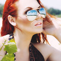 Beautiful red haired woman in sunglasses Stock Photos