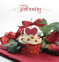 Beautiful red heart valentine theme cupcake with roses and decorations for the month of february sample text or copy space Royalty Free Stock Photo