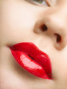Beautiful red lips close up of painted in Stock Photo