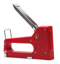 red stapler with a shiny metal handle Royalty Free Stock Photo