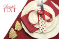 Beautiful red theme festive Christmas dining table place setting Royalty Free Stock Photo