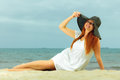 Beautiful redhaired girl in hat on beach portrait holidays vacation travel and freedom concept happy Royalty Free Stock Photo