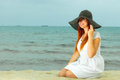 Beautiful redhaired girl in hat on beach portrait holidays vacation travel and freedom concept happy Royalty Free Stock Images