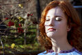 Beautiful redhead basking in the sunlight autumn Royalty Free Stock Photography