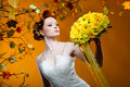 Beautiful redhead bride with a bouquet of flowers Stock Images