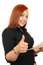 Beautiful redhead business woman with thumbs up showing everything is ok Royalty Free Stock Image