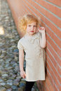 Beautiful redhead girl portrait of a cute little in city Stock Images