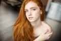 Beautiful redhead woman looking at camera Royalty Free Stock Photo