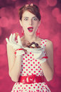 Beautiful redhead women with candy woman photo in retro style bokeh at background Stock Photo