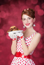 Beautiful redhead women with coockie woman photo in retro style bokeh at background Royalty Free Stock Images