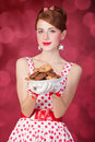 Beautiful redhead women with coockie woman photo in retro style bokeh at background Stock Photos