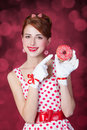 Beautiful redhead women with donut. Royalty Free Stock Photo