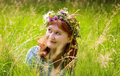 Beautiful redheaded woman in a flower wreath Royalty Free Stock Photos