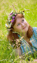 Beautiful redheaded woman in a flower wreath Stock Photos