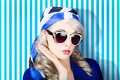 Beautiful retro pinup girl in scarf and sunglasses Royalty Free Stock Photo