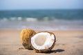 Beautiful ripe coconut the lake broken down into 2 half lies on a white sand beach