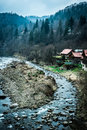 Beautiful river with houses on bank in mountains Royalty Free Stock Photo
